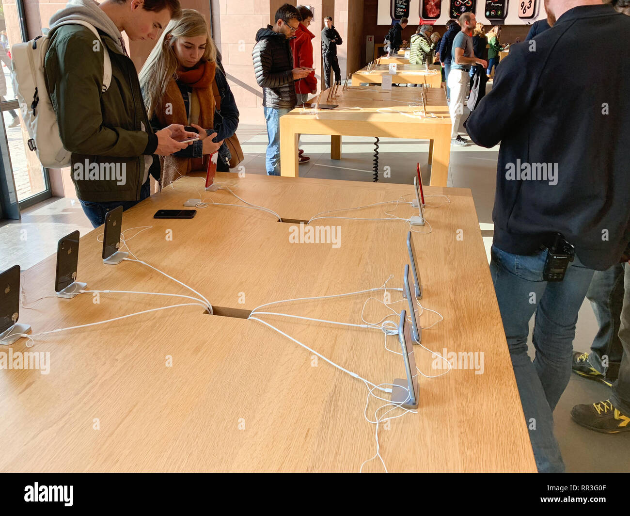 PARIS, FRANCE - OCT 26, 2018: Curiopus customers admiring the latest iPhone XR smartphone in Apple Store Computers during the launch day - Stock Image