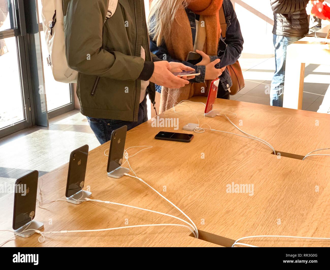 PARIS, FRANCE - OCT 26, 2018: French couple admiring the latest iPhone XR smartphone in Apple Store Computers during the launch day - Stock Image