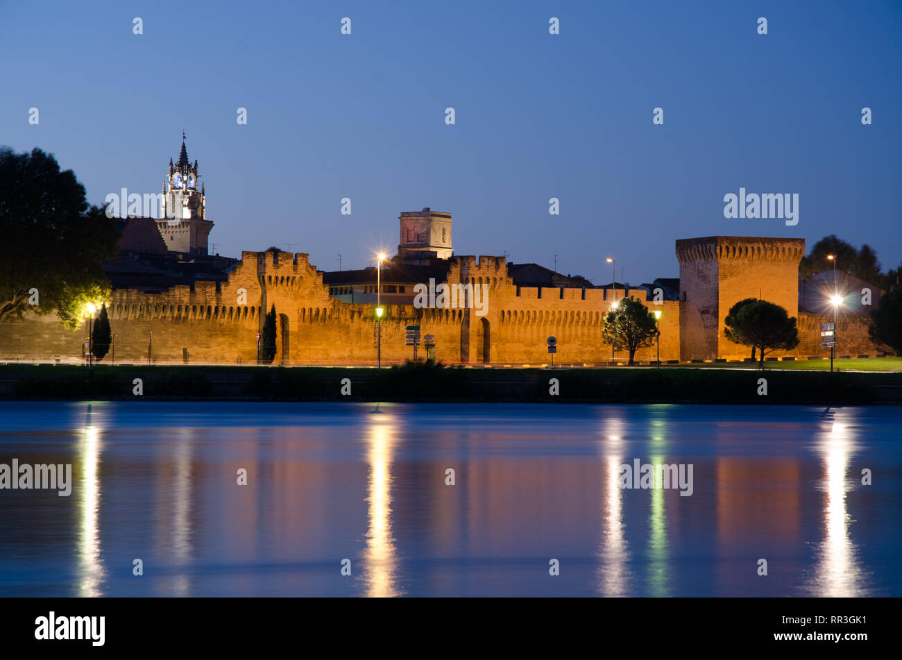 a view of the Pont d'Avignon or Benezet bridge and Palais des Papes of Avignon France - Stock Image