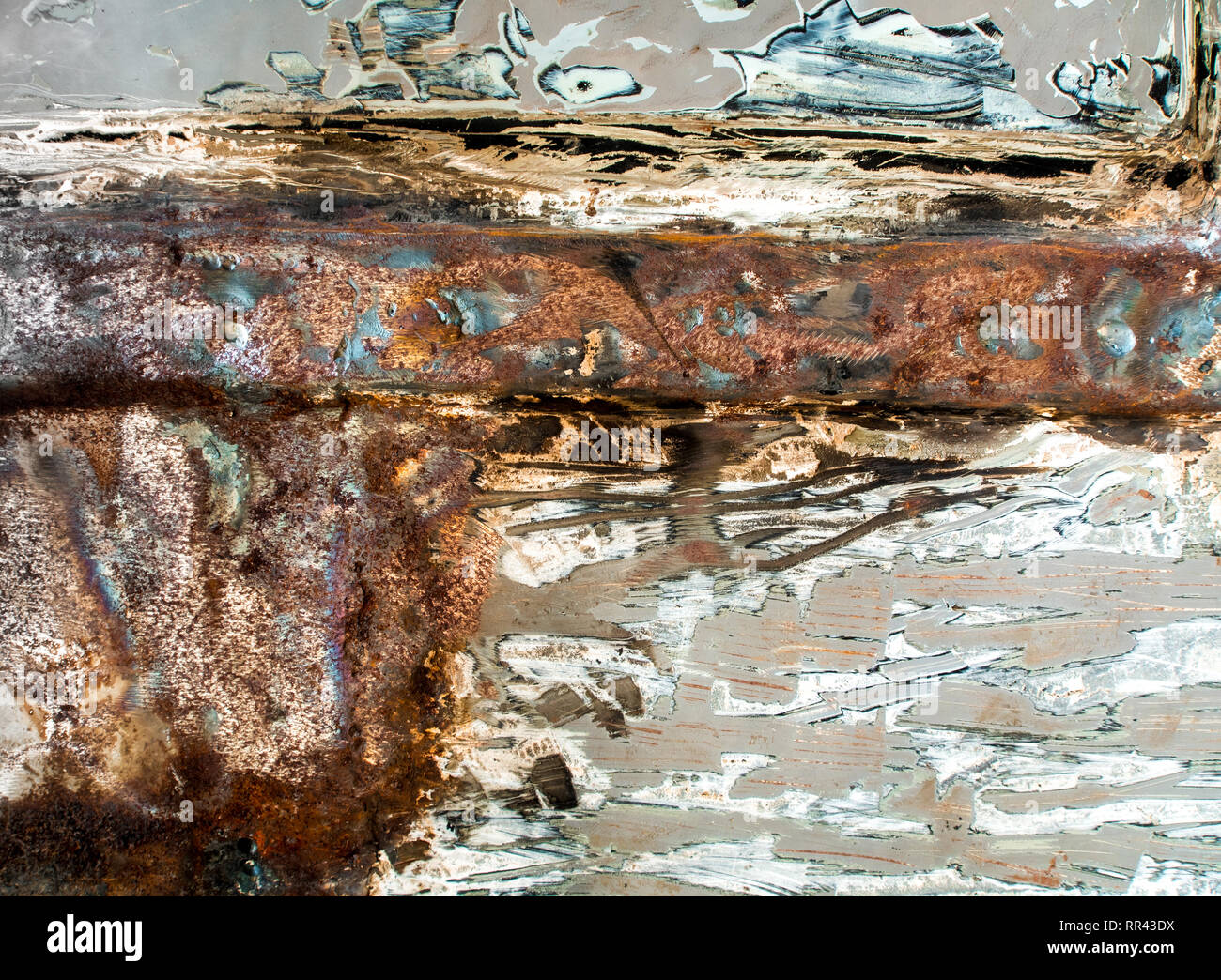 Rusted on surface of old metal plate - Stock Image