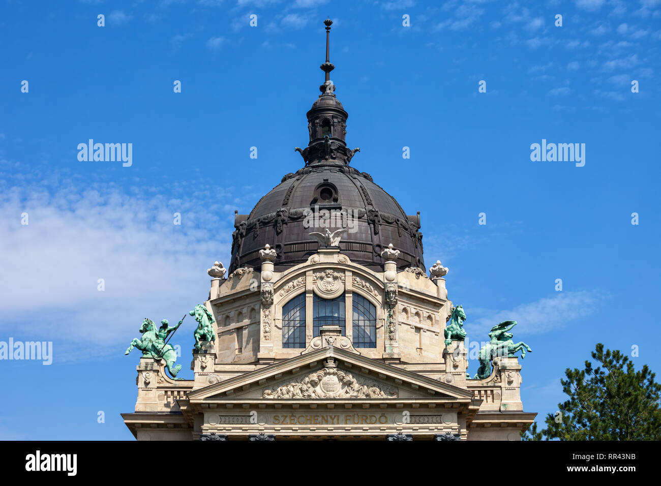 Dome and pediment of Szechenyi Thermal Baths building, Baroque Revival (Neo- Baroque) architecture in city of Budapest, Hungary - Stock Image