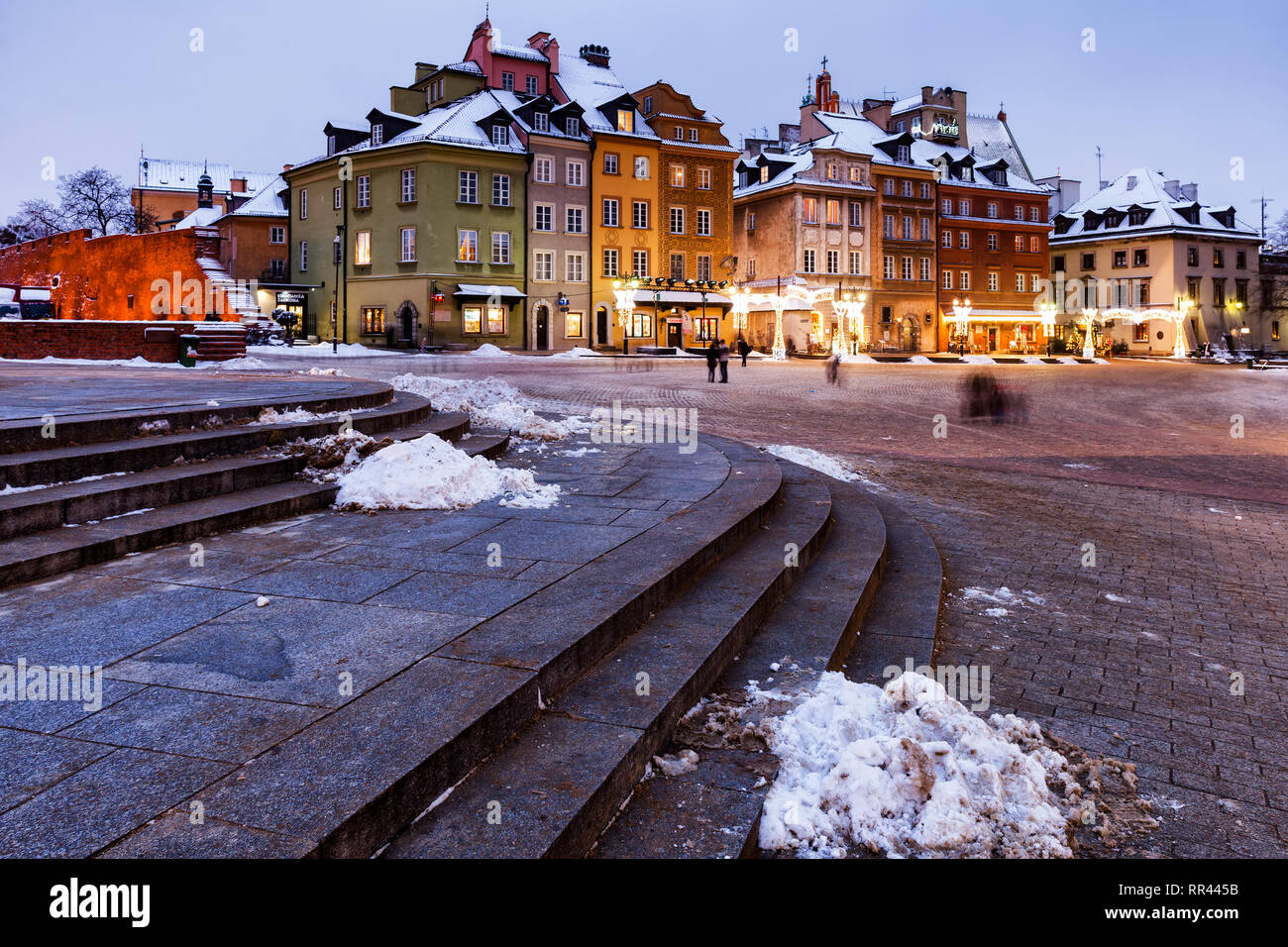 Poland, city of Warsaw in the evening, tenement houses on Castle Square in Old Town, winter time. - Stock Image