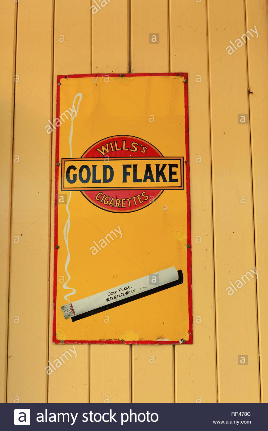 A retro Wills Gold Flake Cigarette Sign At Ramsbottom Railway Station - Stock Image