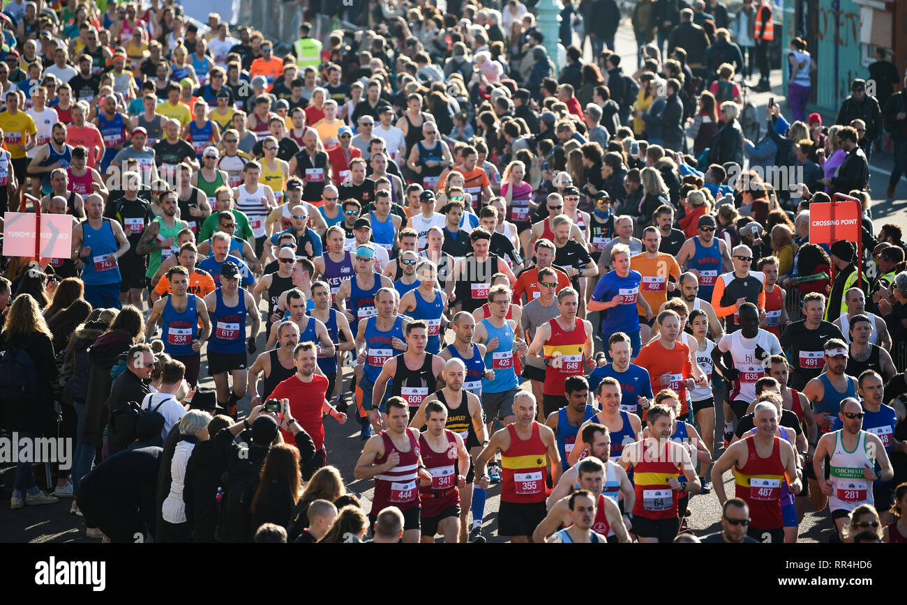 Brighton, UK. 24th Feb, 2019. The start of the Grand Brighton Half Marathon on a beautiful sunny morning with over 13000 runners expected to take part in aid of the Sussex Beacon charity Credit: Simon Dack/Alamy Live News - Stock Image