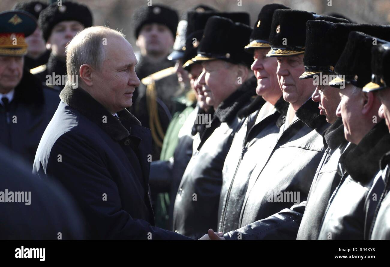 Moscow, Russia. 23rd Feb, 2019. Russian President Vladimir Putin greets veterans during a wreath ceremony at the Tomb of the Unknown Soldier at the Kremlin Wall to honour the memory of fallen soldiers on Defender of the Fatherland Day February 23, 2019 in Moscow, Russia. Credit: Planetpix/Alamy Live News Stock Photo