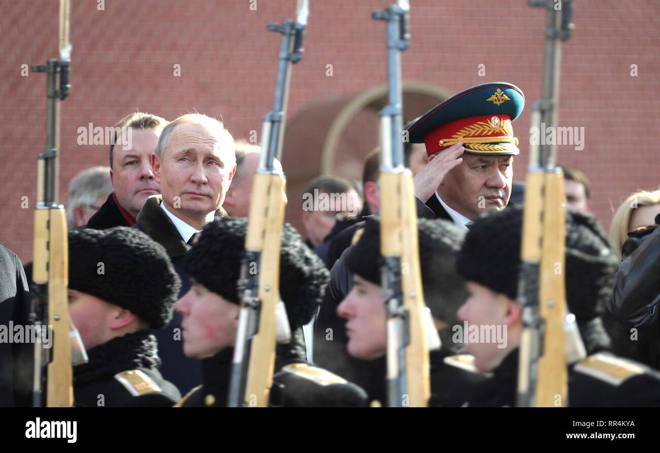 Moscow, Russia. 23rd Feb, 2019. Russian President Vladimir Putin and Defence Minister Sergei Shoigu, right, attend a wreath ceremony at the Tomb of the Unknown Soldier at the Kremlin Wall to honour the memory of fallen soldiers on Defender of the Fatherland Day February 23, 2019 in Moscow, Russia. Credit: Planetpix/Alamy Live News Stock Photo
