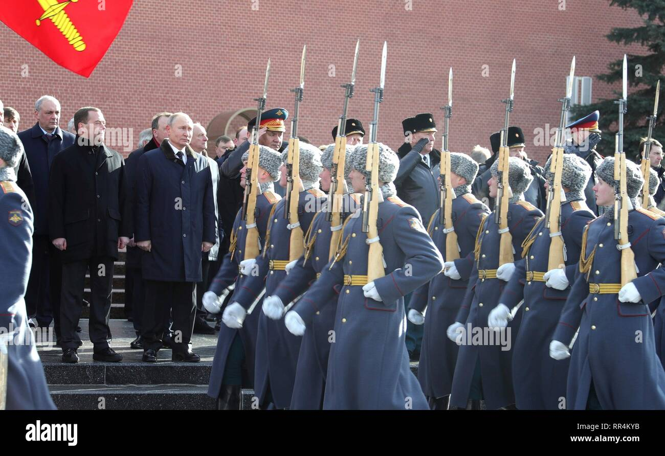 Moscow, Russia. 23rd Feb, 2019. Russian President Vladimir Putin and Prime Minister Dmitry Medvedev attend a wreath ceremony at the Tomb of the Unknown Soldier at the Kremlin Wall to honour the memory of fallen soldiers on Defender of the Fatherland Day February 23, 2019 in Moscow, Russia. Credit: Planetpix/Alamy Live News Stock Photo