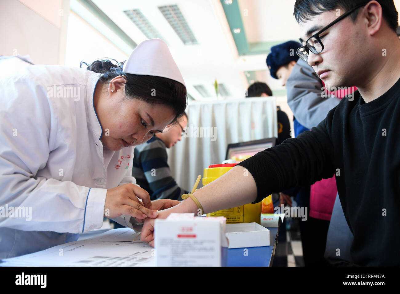 Xilingol. 24th Feb, 2019. Volunteers donate blood for the injured of a mine accident at the blood bank of Xilingol League in north China's Inner Mongolia Autonomous Region, Feb. 24, 2019. A total of 21 people have been killed and 29 others injured after a vehicle lost control due to faulty brakes Saturday at a mining company in northern China's Inner Mongolia Autonomous Region, local authorities said Sunday morning. Credit: Liu Lei/Xinhua/Alamy Live News - Stock Image