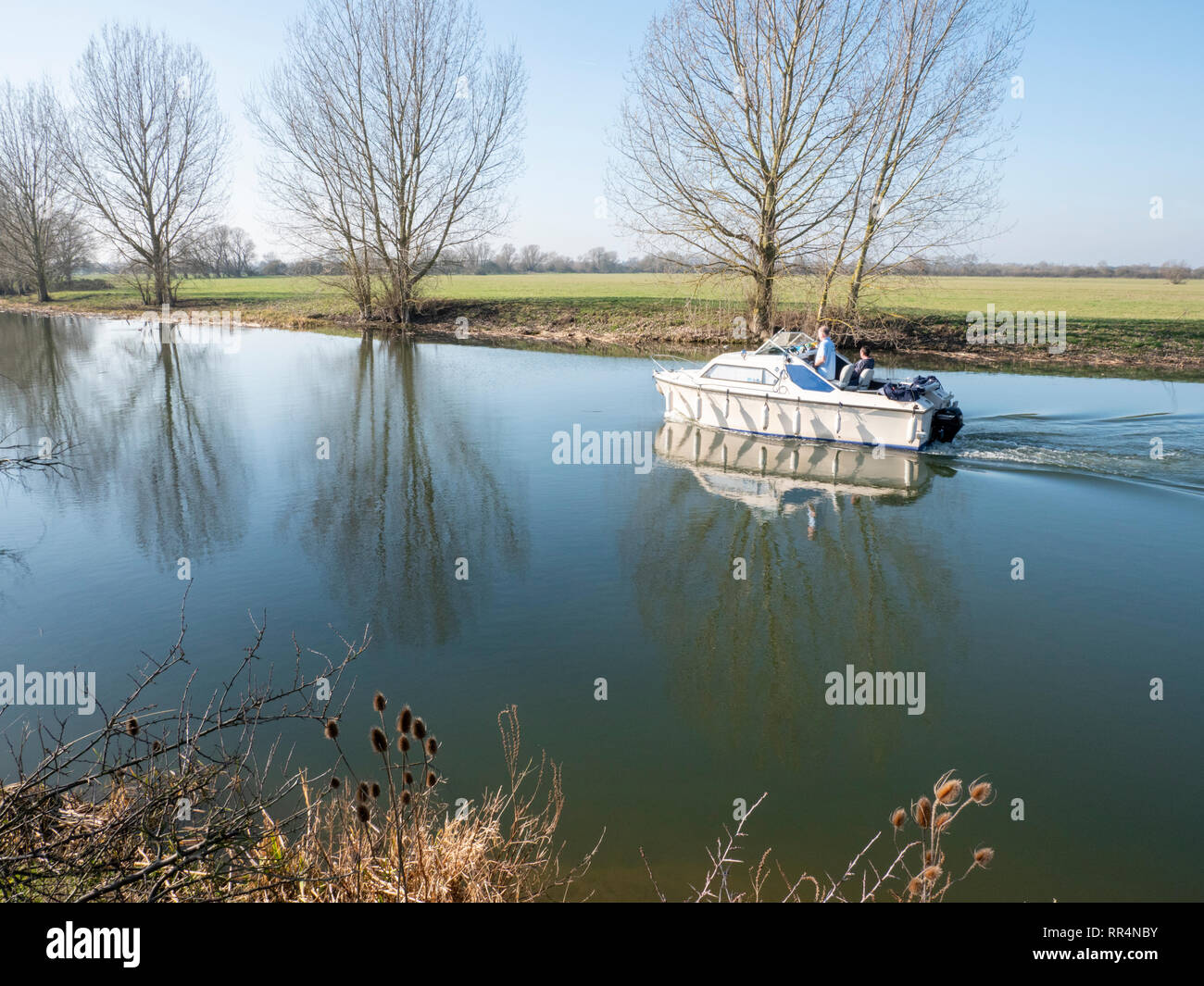Over, Cambridgeshire, UK. 24th Feb 2019. Boaters enjoy messing around on the River Great Ouse in spring like conditions under a cloudless blue sky.  Temperatures rose to around 15 degrees centigrade in the unusually mild weather for the time of year. Credit: Julian Eales/Alamy Live News - Stock Image