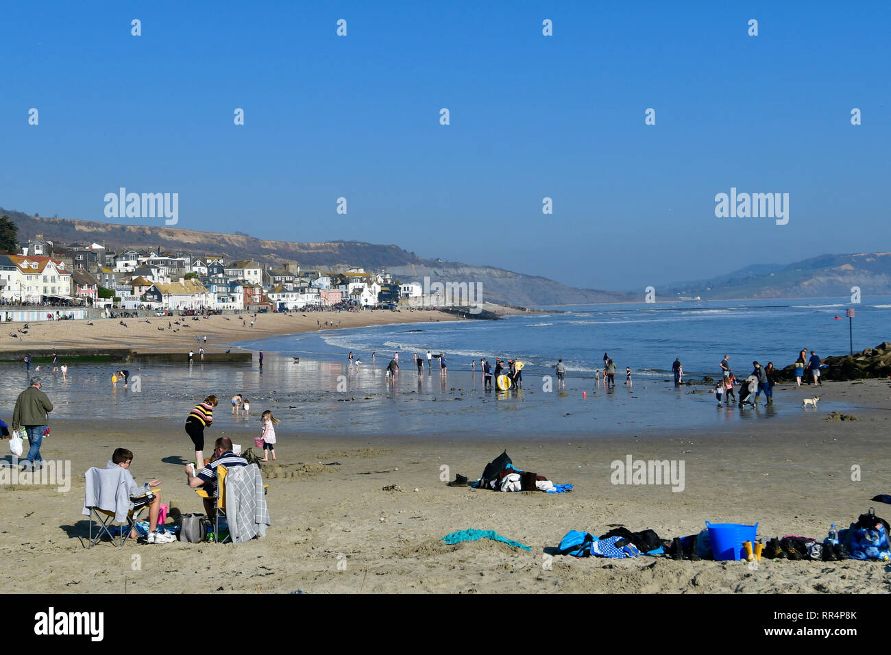 Lyme Regis, Dorset. 24th Feb 2019. UK Weather.Dorset Lyme Regis on the hottest day of the year in February 2019.Thousands of visitors tourist seen at the seaside on a very warm afternoon Credit: Robert Timoney/Alamy Live News - Stock Image