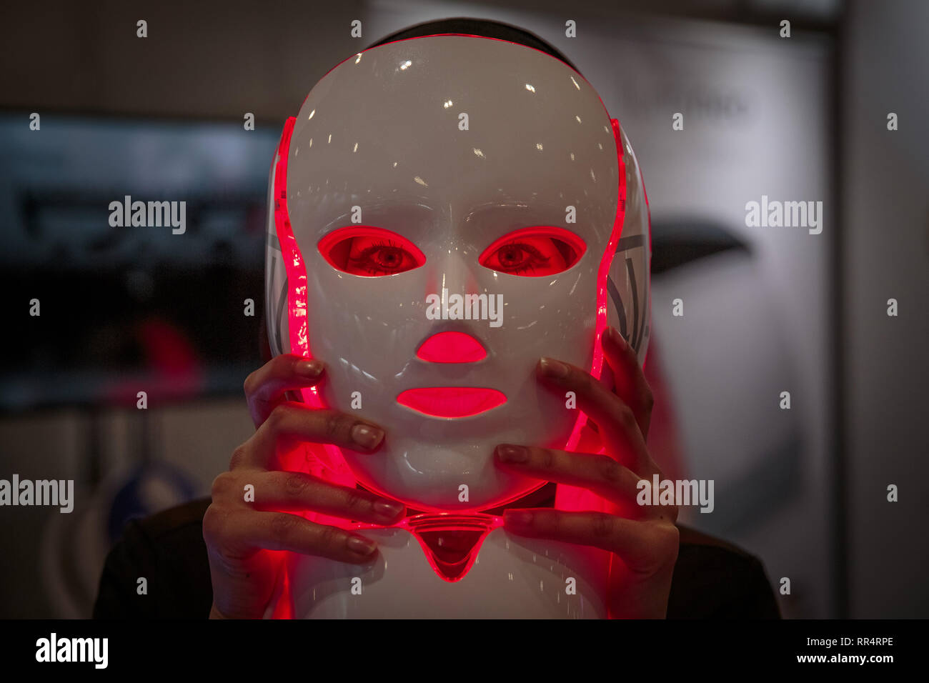 London, UK. 24th Feb, 2019. Infrared skin rejuvenation LED phototherapy facemask technology. LED bulbs set at varying colour temperatures promote blood circulation and anti-aging effect. Professional Beauty London Expo at Excel Centre, the UK's biggest beauty and spa trade show. Credit: Guy Corbishley/Alamy Live News - Stock Image