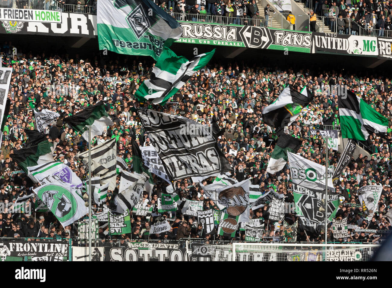 sports, football, Bundesliga, 2018/2019, Borussia Moenchengladbach vs VfL Wolfsburg 0-3, Stadium Borussia Park, football fans of Gladbach, football enthusiasm, flags, DFL REGULATIONS PROHIBIT ANY USE OF PHOTOGRAPHS AS IMAGE SEQUENCES AND/OR QUASI-VIDEO - Stock Image