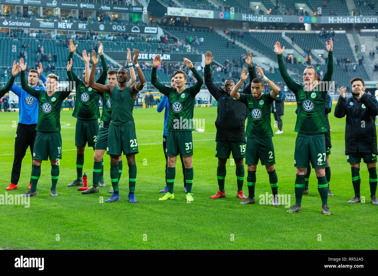 sports, football, Bundesliga, 2018/2019, Borussia Moenchengladbach vs VfL Wolfsburg 0-3, Stadium Borussia Park, after the game Wolfsburg players and football fans rejoicing at the win, DFL REGULATIONS PROHIBIT ANY USE OF PHOTOGRAPHS AS IMAGE SEQUENCES AND/OR QUASI-VIDEO - Stock Image