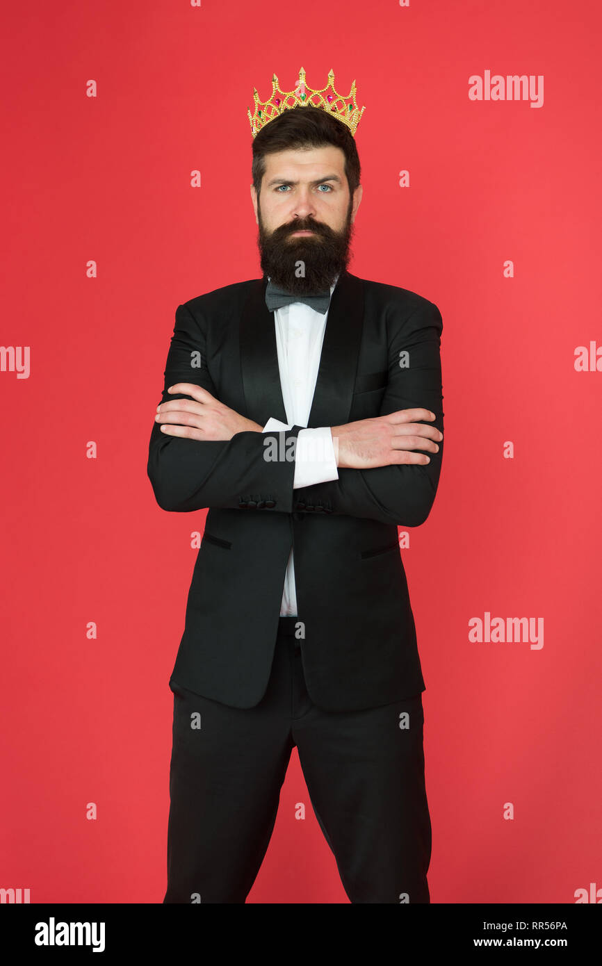 Formal wear male fashion for big boss. Bearded big boss man in tuxedo and bow tie. Egoist. Businessman in tuxedo and crown. Big boss. Formal event. King crown. Man groom in suit. Confident big boss. - Stock Image