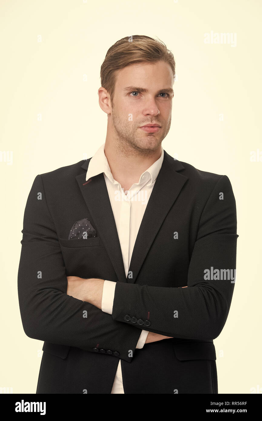He is on style. Man well groomed unbuttoned white collar stylish formal suit isolated white background. Macho confident perfect outfit handkerchief pocket. Guy office worker handsome stylish outfit. - Stock Image