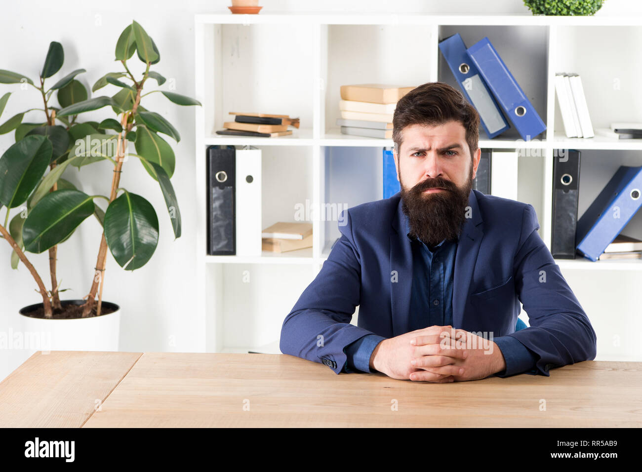 Ready to hear your opinion. Report and complaint concept. Man bearded hipster boss looking at you with attention. Boss sit in office. Boss receive complaints. Meeting with boss. I am listening. - Stock Image
