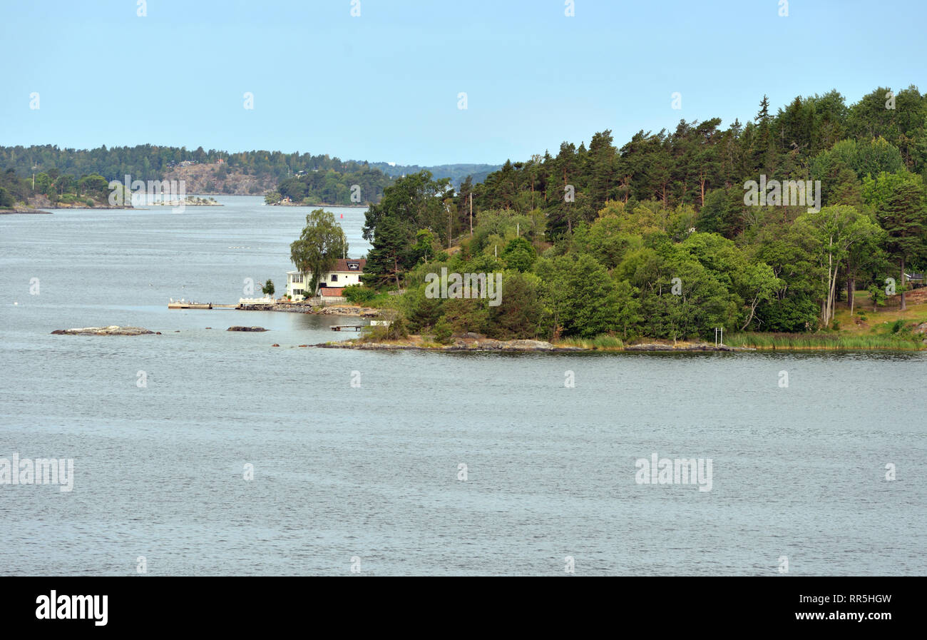 Stockholm archipelago in Baltic Sea. Summer landscape with white house on shore - Stock Image