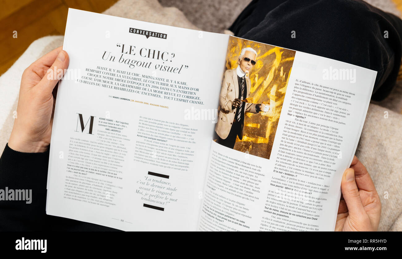 Paris France Feb 23 2019 Woman Reading French Magazine Covering Karl Lagerfeld Death Iconic Fashion Designer Died Aged 85 Article About Le Chic Stock Photo Alamy