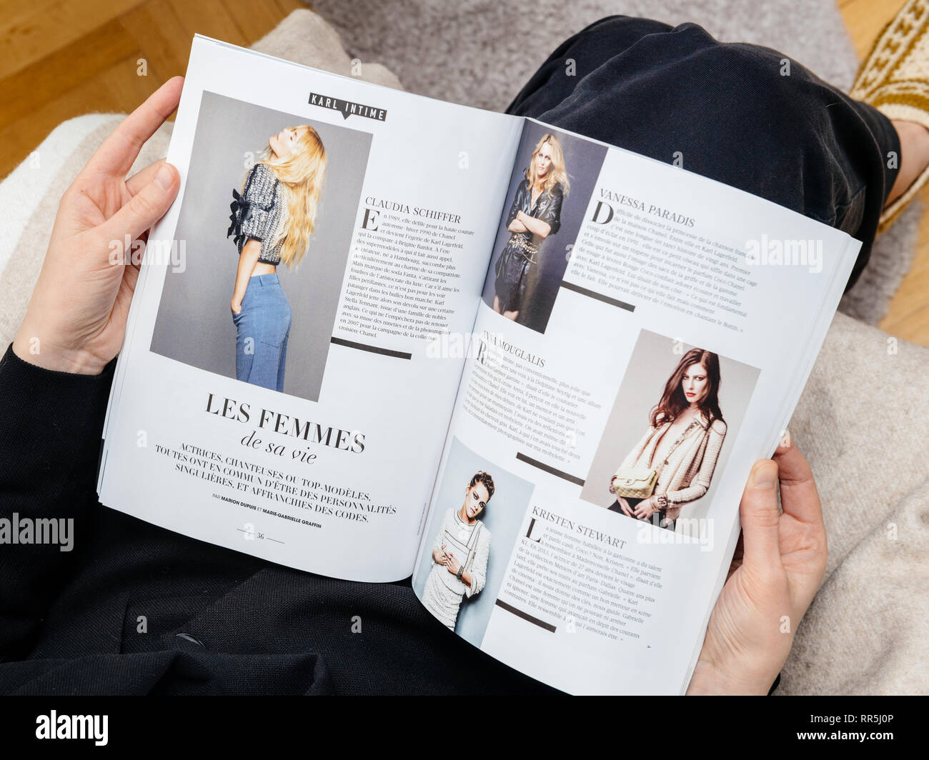 Paris France Feb 23 2019 Woman Reading French Magazine Covering Karl Lagerfeld Death Iconic Fashion Designer Died Aged 85 Article Women S Off His Life Stock Photo Alamy