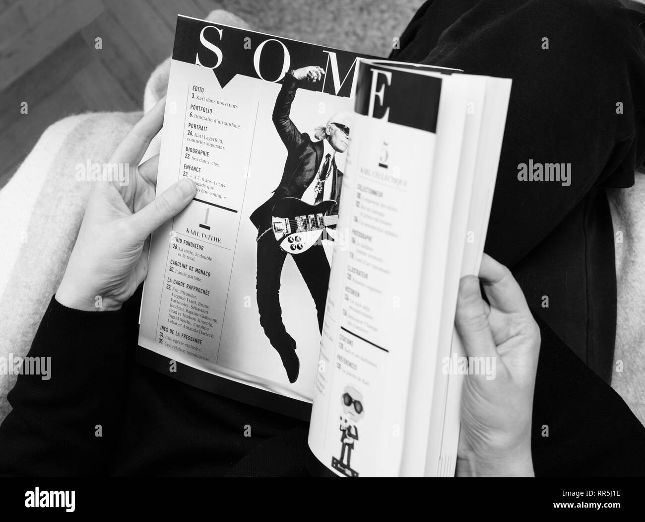 Paris France Feb 23 2019 Woman Reading French Magazine Covering Karl Lagerfeld Death Iconic Fashion Designer Died Aged 85 Summary With Karl Playing Electric Guitar Black And White Stock Photo 237995786 Alamy