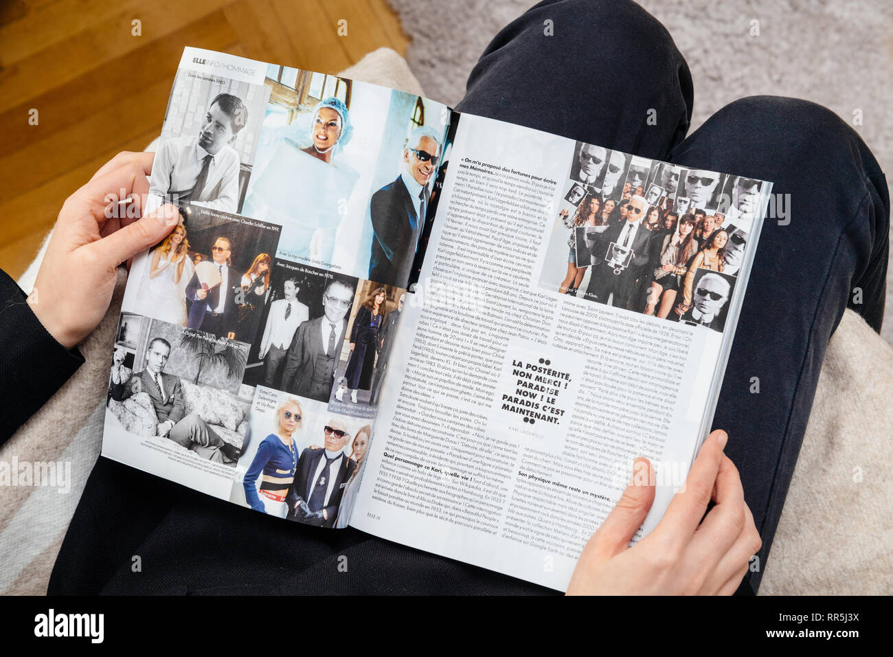 Paris France Feb 23 2019 Woman Reading French Magazine Covering Karl Lagerfeld Death Iconic Fashion Designer Died Aged 85 And Was Creative Director Paradise Now Article Stock Photo Alamy