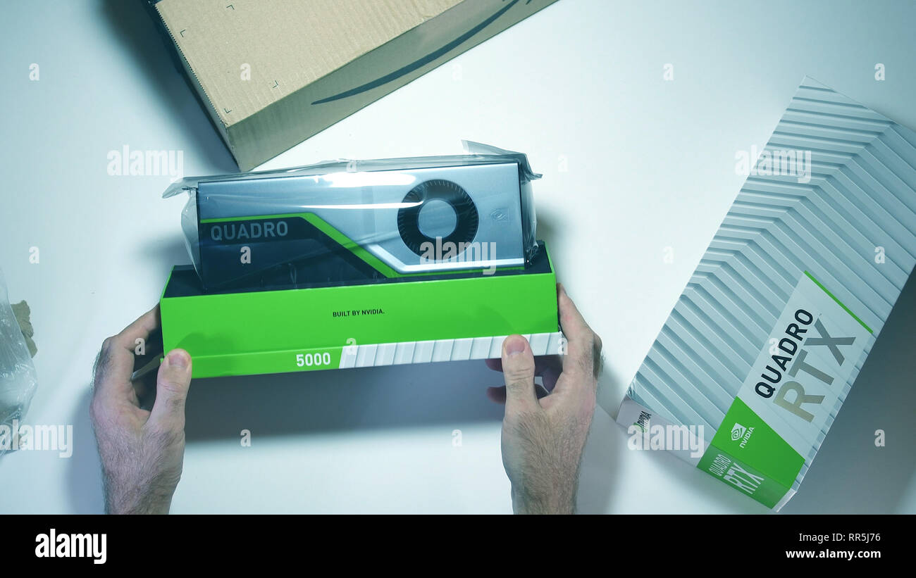 Paris, France - Feb 20, 2019: Unpacking latest Nvidia Quadro RTX 5000 workstation professional video card GPU for CAD CGI scientific calculations and machine learning - Stock Image