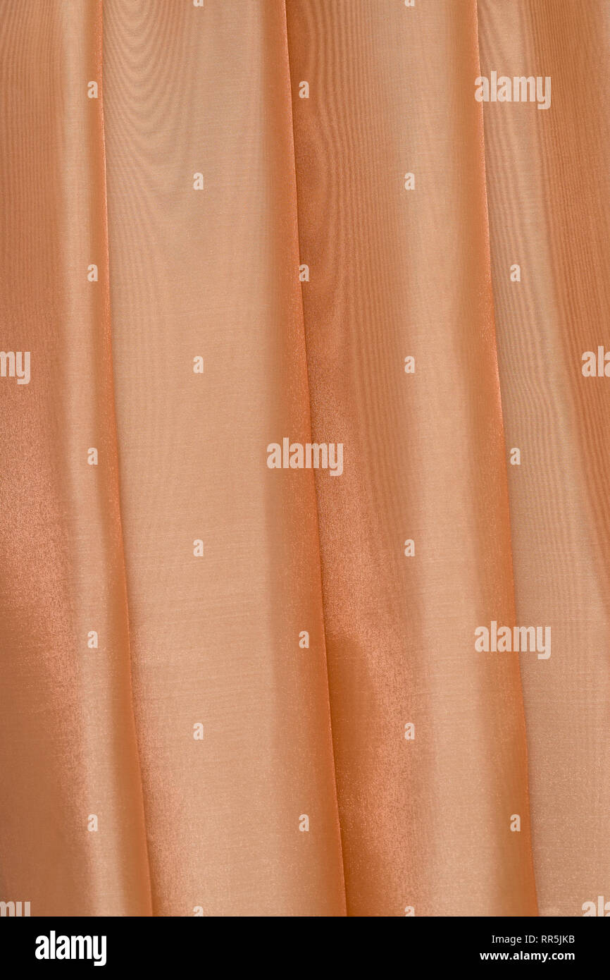 Vertical folds on lightish organza curtains - Stock Image