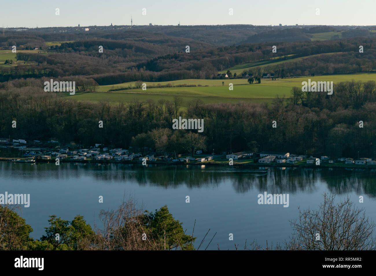 View over Ruhr river of large forest and farm lands in Germany - Stock Image