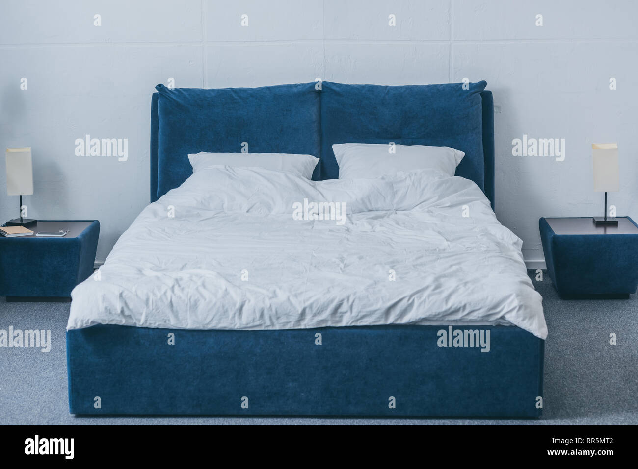 Modern Interior Design Of Bedroom With Bedside Tables Lamps And Bed With White Bedding Stock Photo Alamy