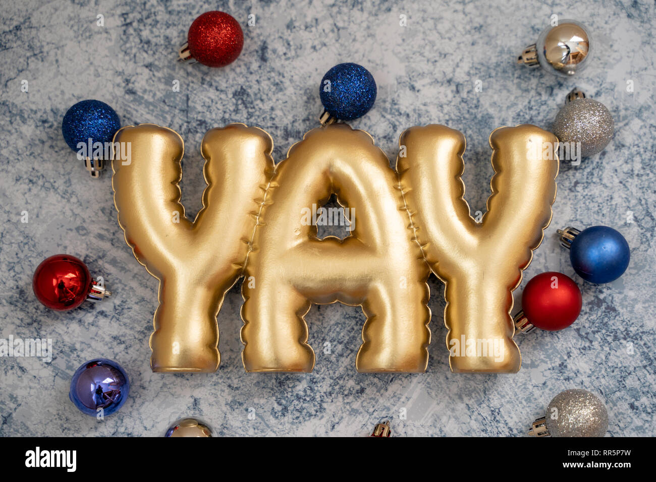 Festive Patriotic Usa American Christmas Background Featuring Ornaments In Red White And Blue Colors On Blue Marble Background Yay Word In Gold Lette Stock Photo Alamy