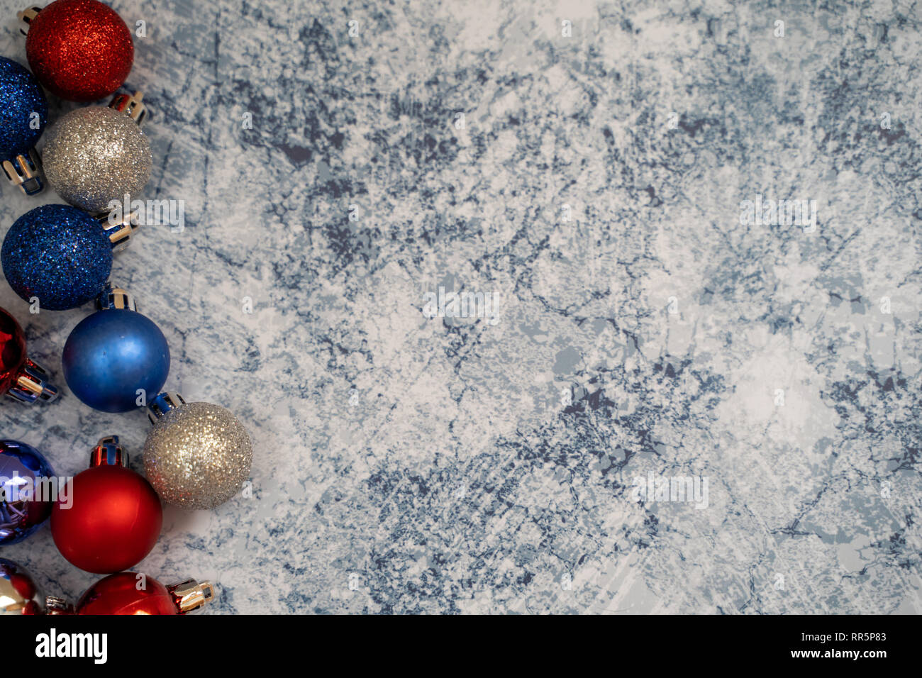 Festive Patriotic Usa American Christmas Background Featuring Ornaments In Red White And Blue Colors On Blue Marble Background Stock Photo Alamy