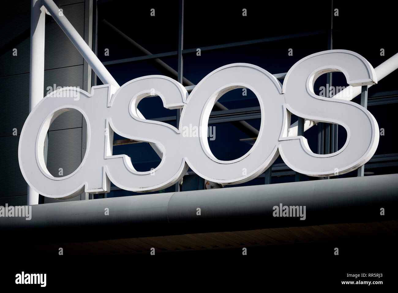 The signage of Asos above the company's distribution warehouse in the outskirts of Barnsley, UK (Editorial use only) - Stock Image