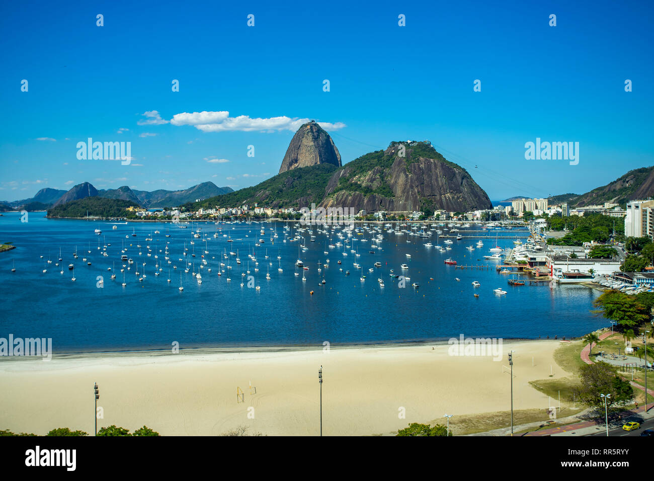 Exotic mountains. Famous mountains. Mountain of the Sugar Loaf in Rio de Janeiro, Brazil South America. Panoramic view of boats and yachts in the mari - Stock Image
