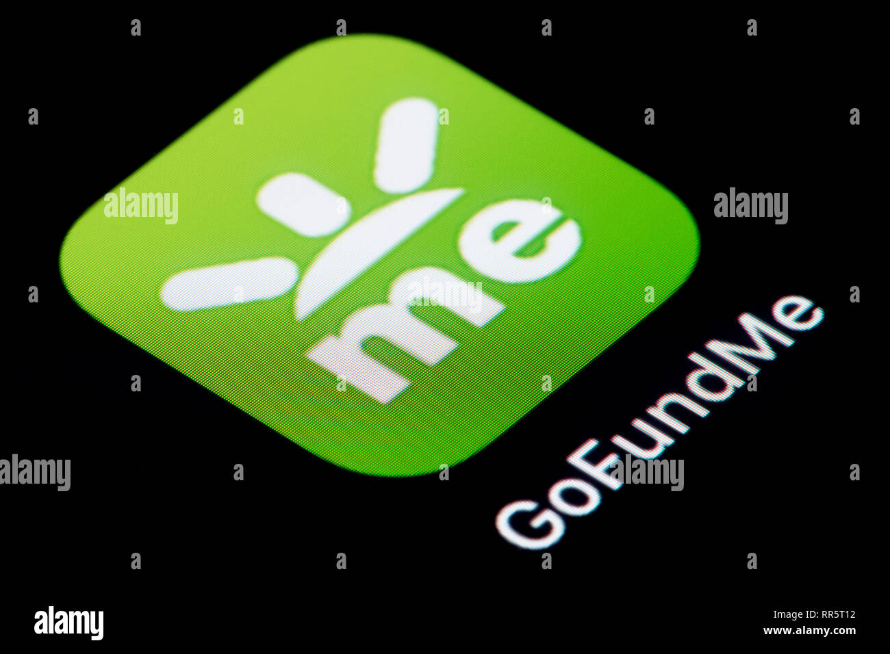 A close-up shot of the GoFundMe app icon, as seen on the screen of a smart phone (Editorial use only) - Stock Image