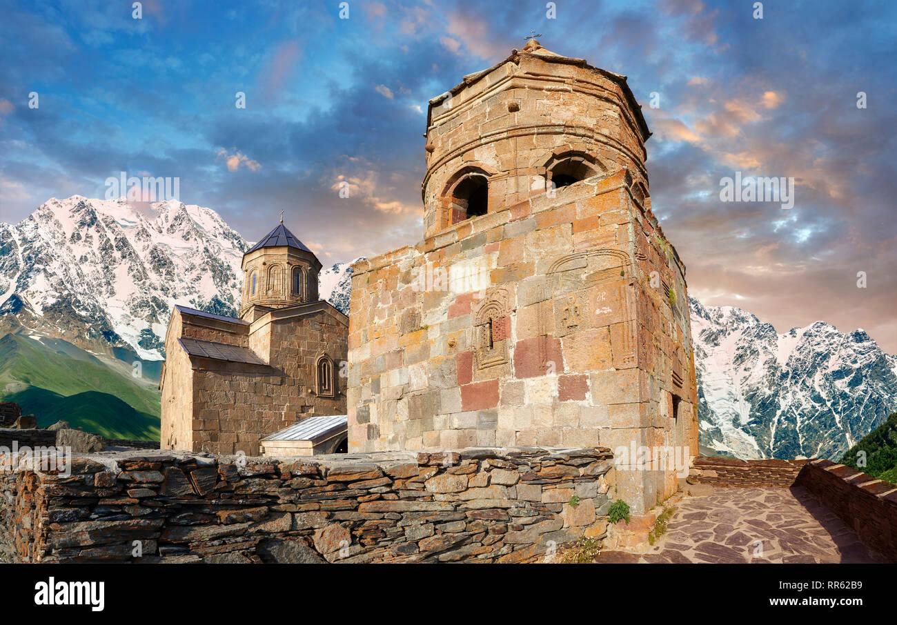 Pictures & images of Gergeti Holy Trinity (Tsminda Sameba) Georgian Orthodox and Apostolic Church bell tower, 14th century, Gergeti, Khevi province, G - Stock Image