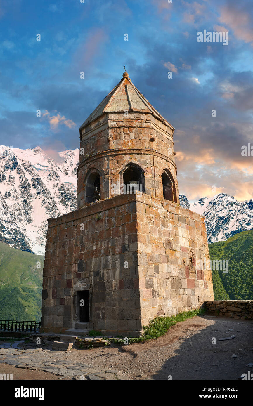 Pictures & images of Gergeti Holy Trinity (Tsminda Sameba) Georgian Orthodox and Apostolic Church bell tower, 14th century, Gergeti, Khevi province, G - Stock Image