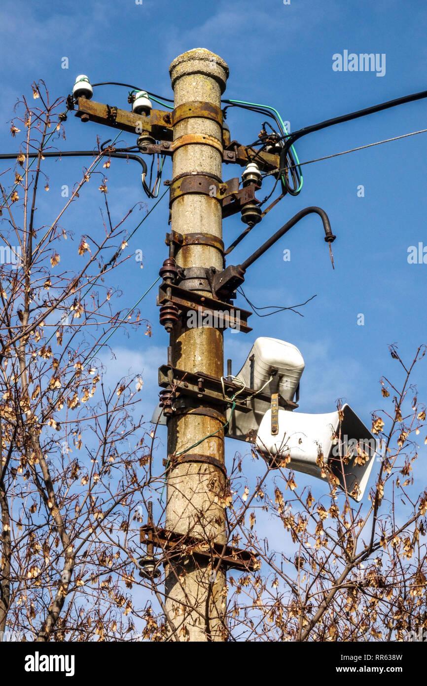 Old loud-speakers on pole, Czech village - Stock Image
