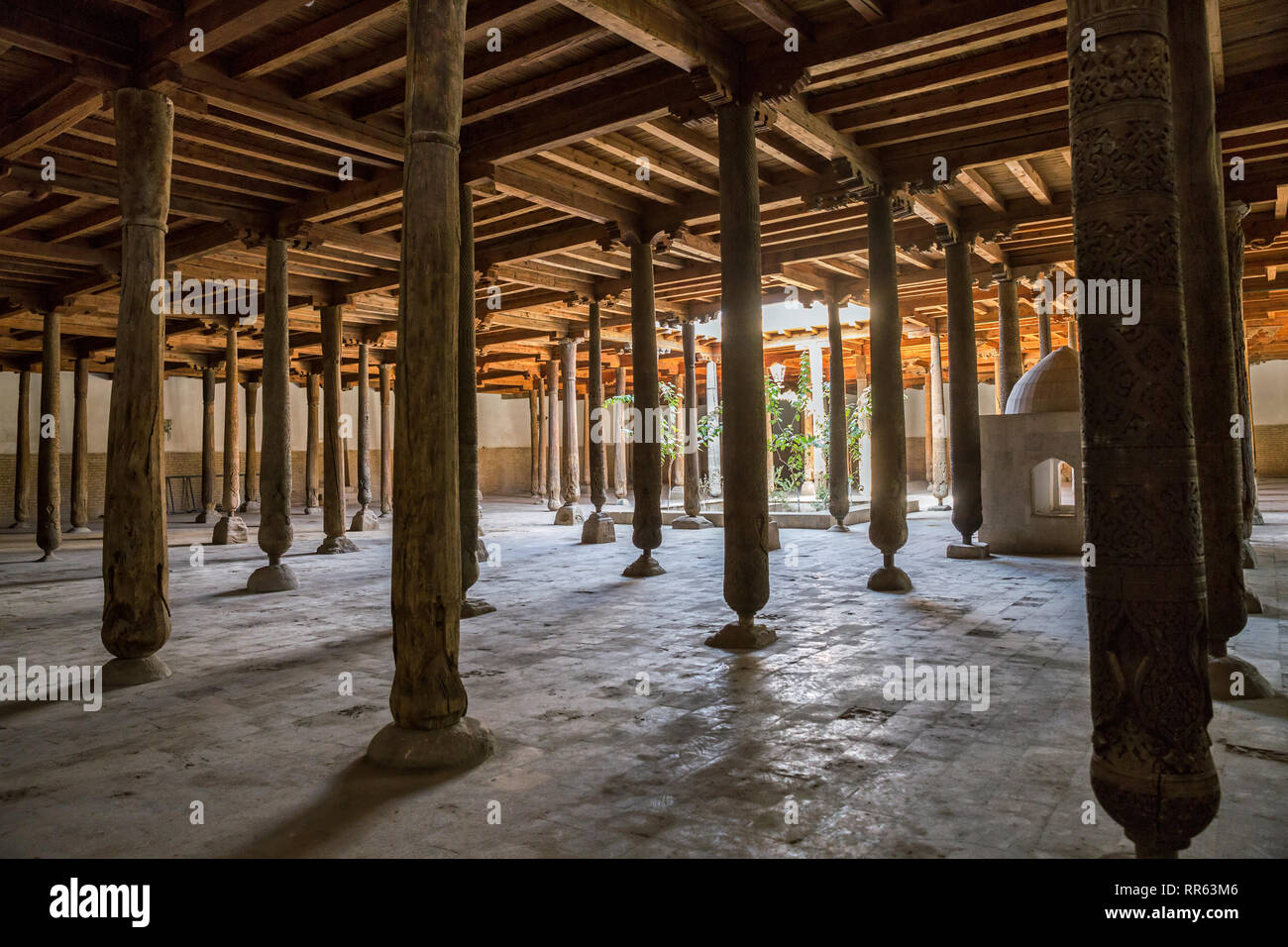 Carved wooden columns of the Juma mosque (Friday mosque) in the Khiva fortress Ichan-Kala, Uzbekistan - Stock Image