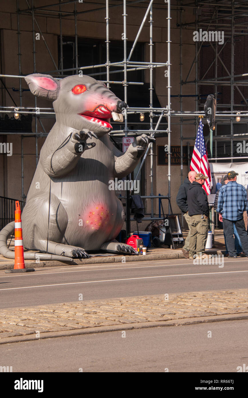 Philadelphia, Pennsylvania - February 5, 2019: Inflatable rat is seen on the city street in front of a non-union construction site with protestors see - Stock Image