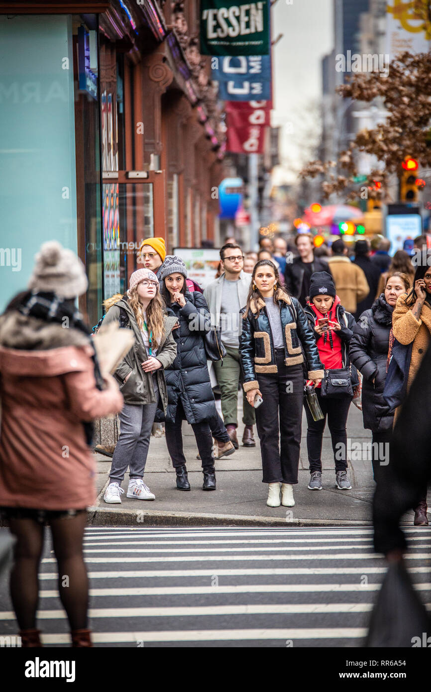 NEW YORK CITY - DECEMBER 14, 2018: Winter street scene in New York City Manhattan with real people in everyday situation on busy urban street - Stock Image