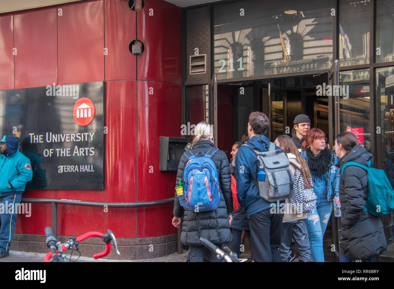 Philadelphia, Pennsylvania - February 5, 2019: Students are seen entering and leaving via the front door of The University of the Arts on Broad Street - Stock Image