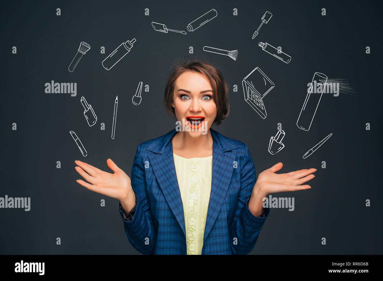 Woman amazing facial expression juggles sketch cosmetic beauty products. - Stock Image
