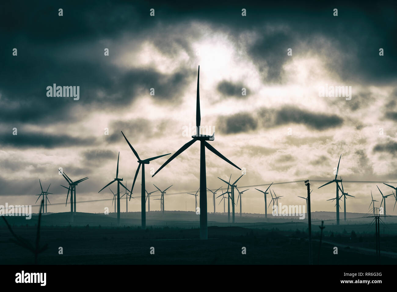 View of wind turbines at sunset at Blacklaw Wind Farm in Scotland, UK - Stock Image
