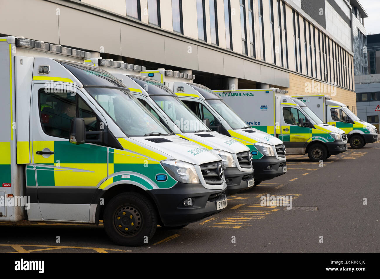 Ambulances parked outside Accident and Emergency department at Queen Elizabeth University Hospital in Glasgow, Scotland, UK - Stock Image