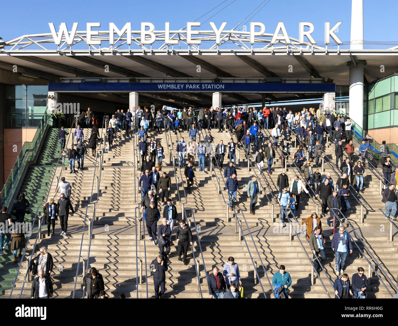 24 Feb 2019 - London, England. People arrived at Wembley Park station walking towards the stadium to watch Carabao Cup Finals. - Stock Image
