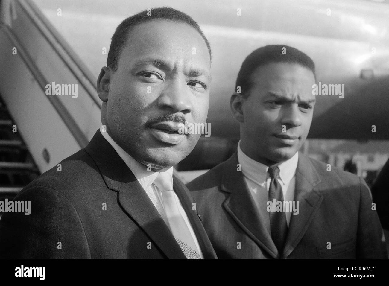Martin Luther King, Jr. and Andrew Young arriving at Schiphol Airport in Amsterdam, North Holland on August 15, 1964. King had traveled to the Netherlands to speak at the European Baptist Federation Congress at the RAI convention center on Sunday, August 16 in Amsterdam. - Stock Image