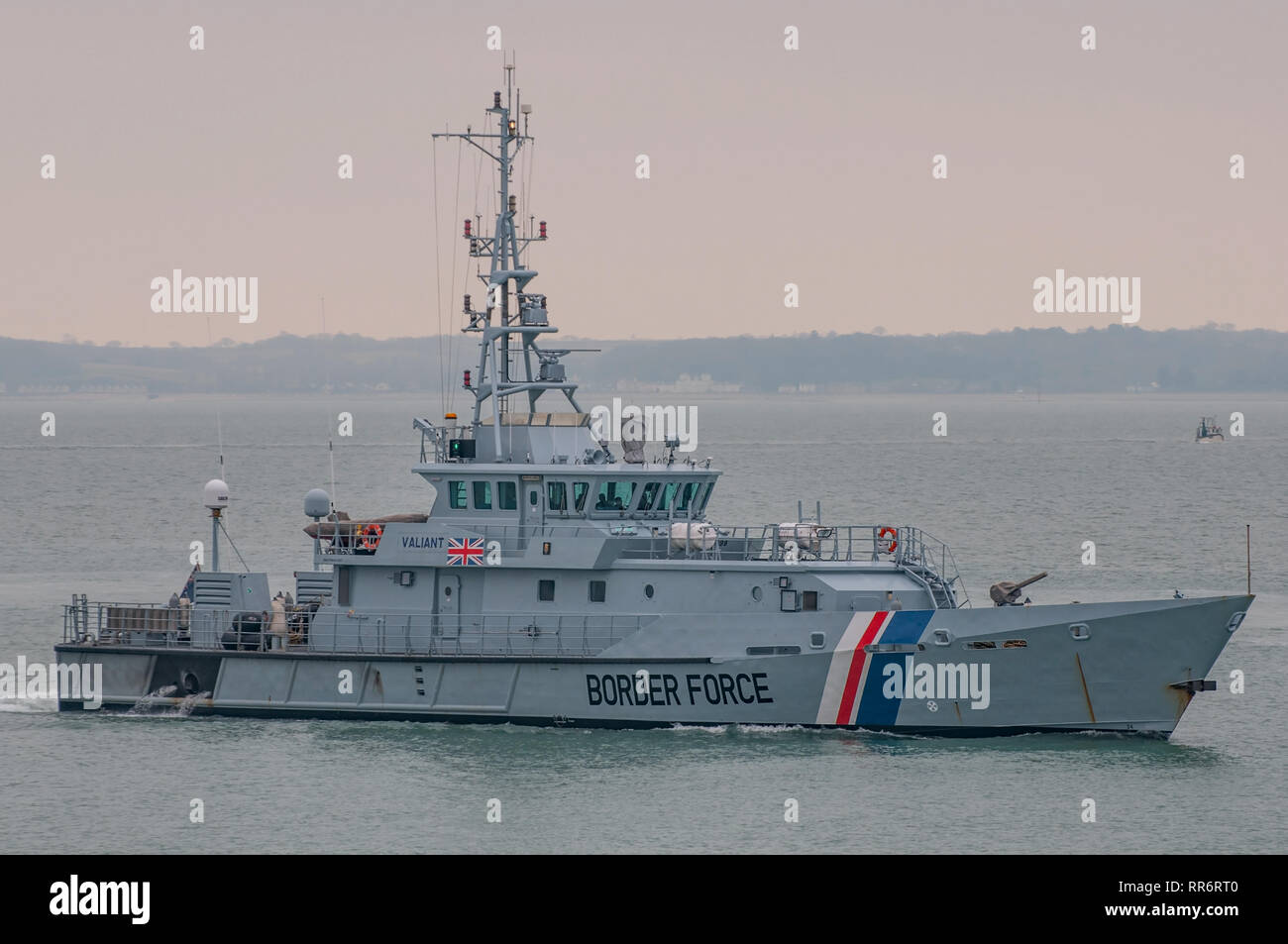 The UK Border Force cutter HMC Valiant approaching it's operating base in Portsmouth Harbour, UK on the 18th March 2016. Stock Photo