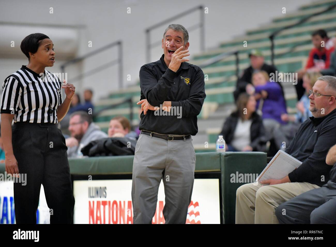 Head coach having an animated discussion with an official after disagreeing with a call. USA. Stock Photo