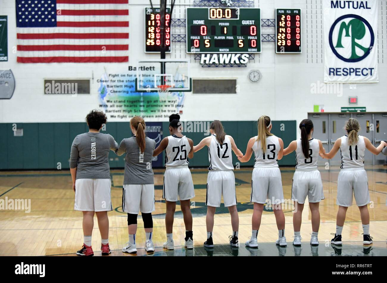 Prior to the start of their game, a team binds together during the playing of the 'National Anthem.' USA. - Stock Image