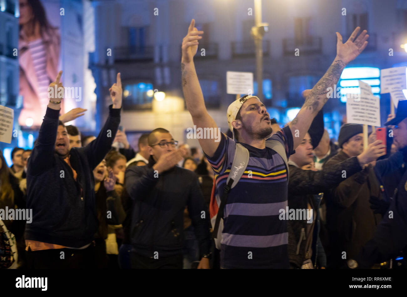 Madrid, Spain. 24th Feb, 2019. Clashes between supporters of Maduro and the opposition took place in Madrid. The origin of the dispute was a demonstration organized by the supporters of Maduro at Puerta del Sol to protest against the intervention of Spain in Venezuela. Venezuelan citizens of the opposition showed up and the intervention of the police was necesary to avoid any stronger confrontations between both parts.  In the picture, the opposition of Maduro protesting. Credit: Lora Grigorova/Alamy Live News - Stock Image